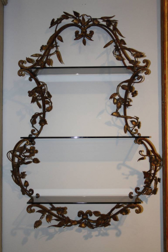 An Italian Florentine metal wall shelf