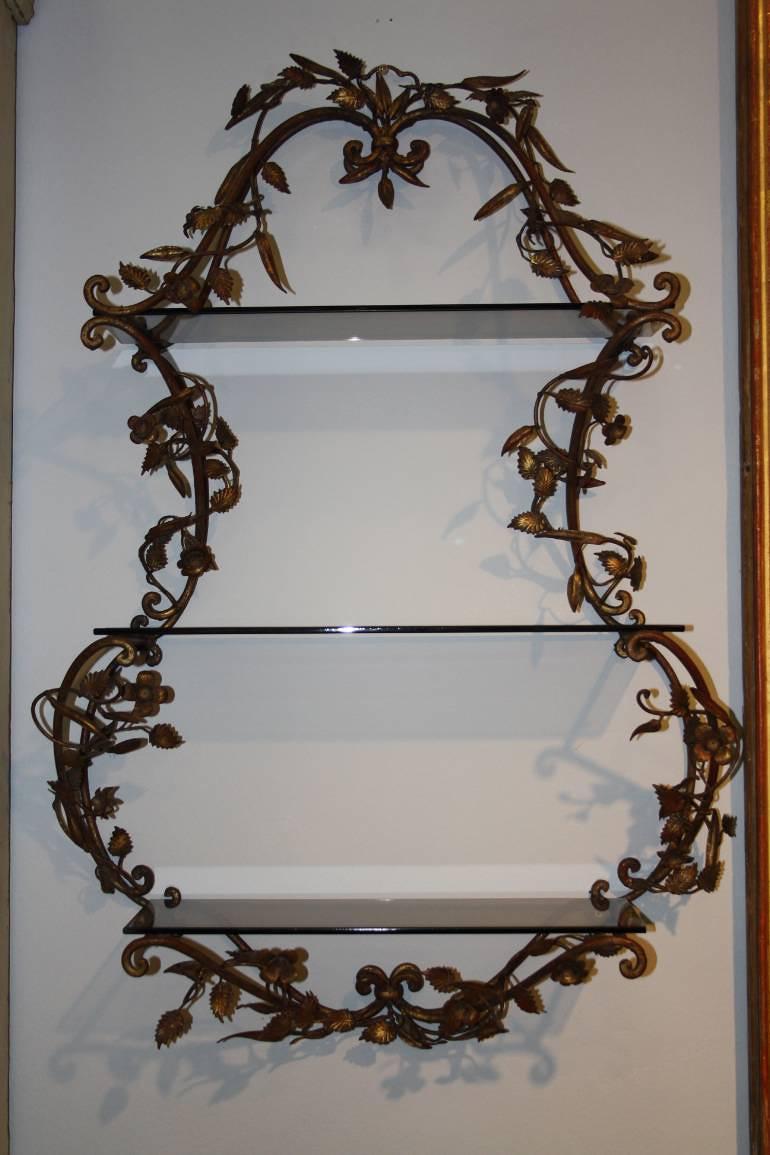 An Italian Florentine metal wall shelf