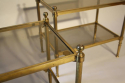A pair of glass and brass two tier end tables - picture 3
