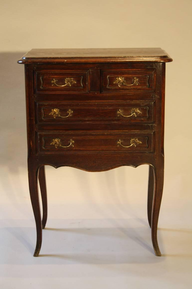 Louis XVI style four drawer oak side cabinet