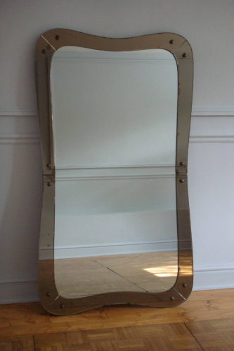 Elegantly shaped 1950`s Italian mirror with brown glass border. Original condition