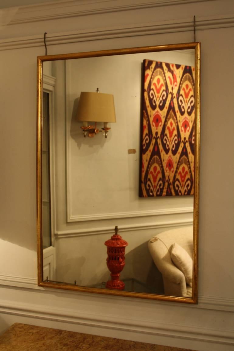 Narrow framed soft gold bistro mirror
