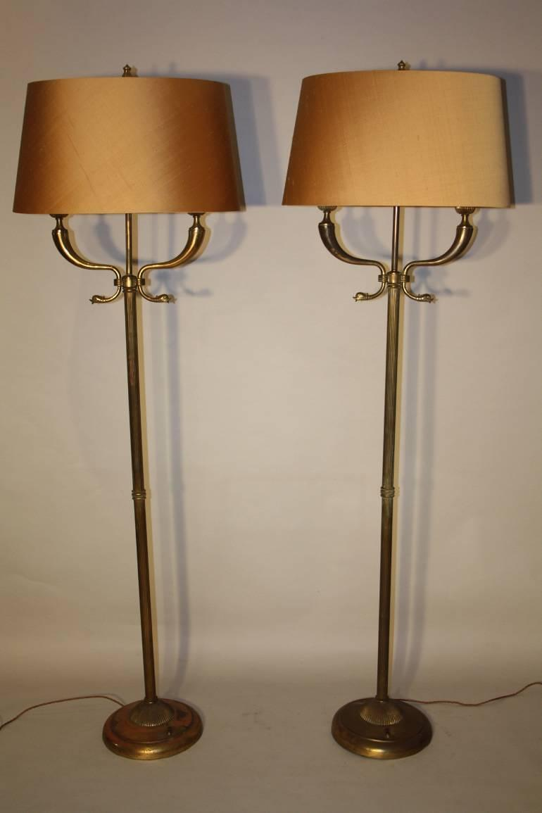 A pair of Dolphin head floor lamps