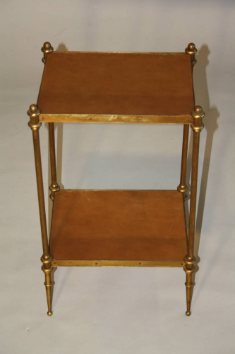 A small elegant two tier leather and brass side table. French c1950`s, stamped Hermes
