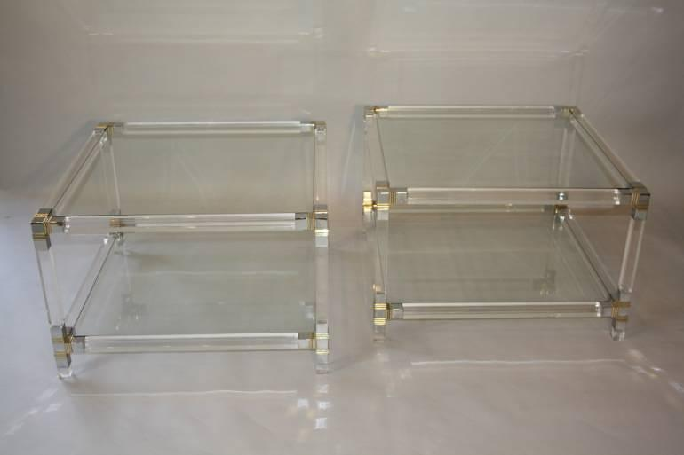 A pair of lucite two tier tables, French c1970