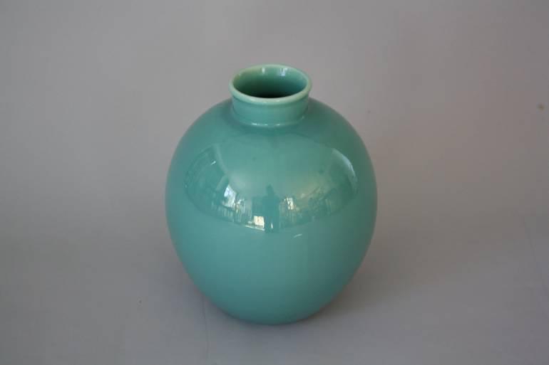 A large pale jade green vase