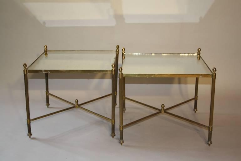 A pair of 1950`s brass and mirror side tables.