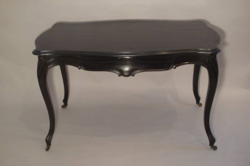 An elegant ebonised desk/centre table with drawer. French Napoleon III c1890
