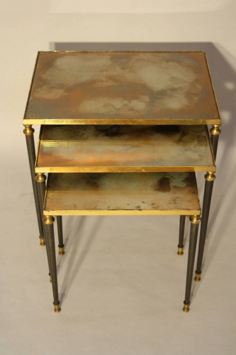 Nest of tables with unusual brown/orange/gold mirror glass.