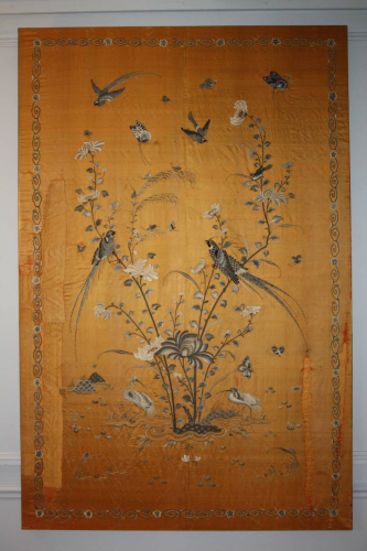A yellow/gold hand embroidered silk panel