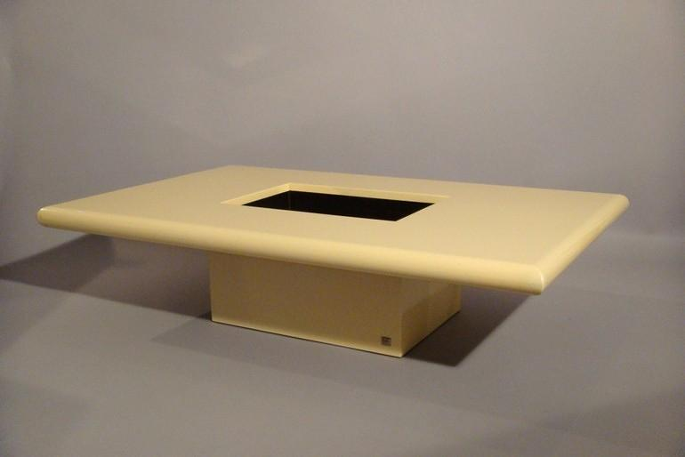 Cream lacquer coffee table designed and made by Jean Claude Mahey, France 1970 with original smoke glass interior