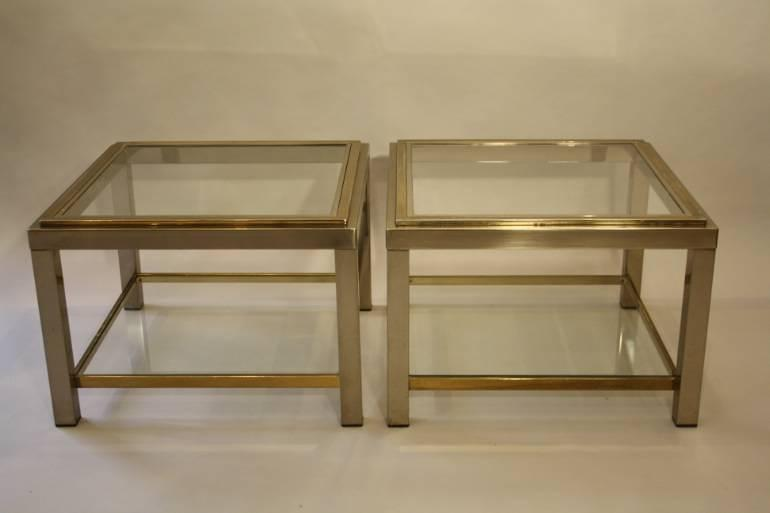 A pair of silver and gold two tier side tables, French c1970