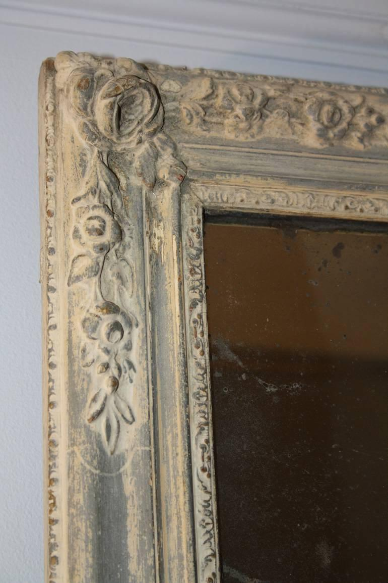 Distressed painted blue grey mirror with original mercury glass plate. French C19th