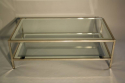 A silver and mirror edged glass two tier table - picture 1