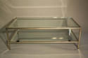 A silver and mirror edged glass two tier table - picture 2