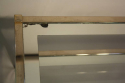 A silver and mirror edged glass two tier table - picture 4
