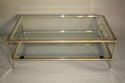 A silver and mirror edged glass two tier table - picture 5