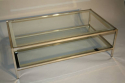 A silver and mirror edged glass two tier table - picture 6
