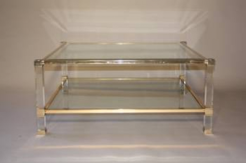 A square lucite framed Pierre Vandel coffee table