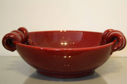A sang de boeuf glazed ceramic Vallauris open bowl. French c1950