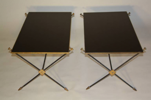 A pair of black vitrolite, crossed arrow 1950`s French end tables.