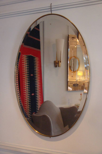 Simple and elegant oval gold metal banded bevelled glass mirror, Italian c1950