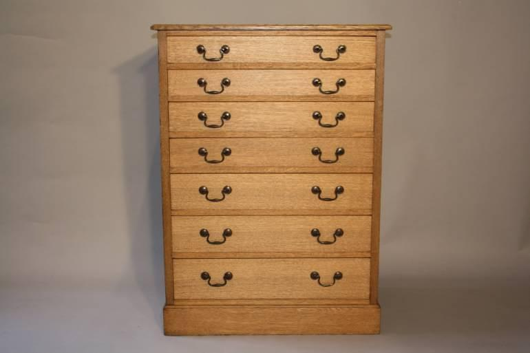 1920`s English Oak graduated seven drawer chest of drawers