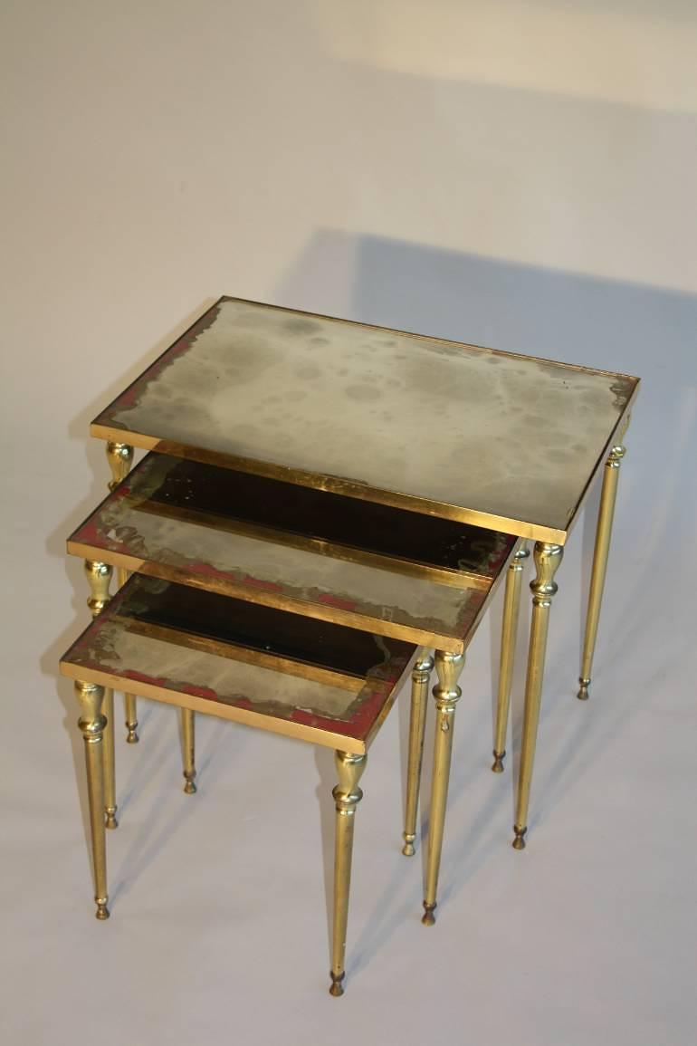 Brass and mirror nest of tables, French c1960