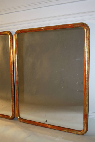 A pair of C19th narrow edge gilt framed mirrors with mercury plate.