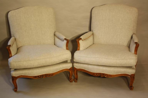 A pair of carved wood French fauteuils