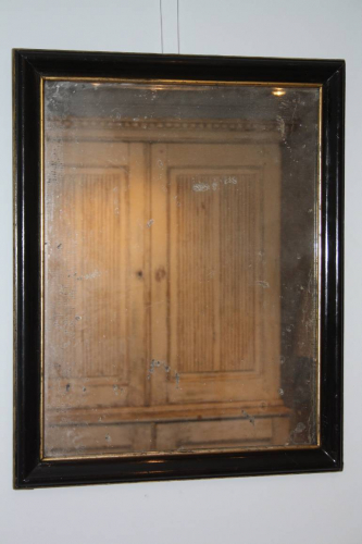 A French Antique Napoleon III ebonised and gilt mirror