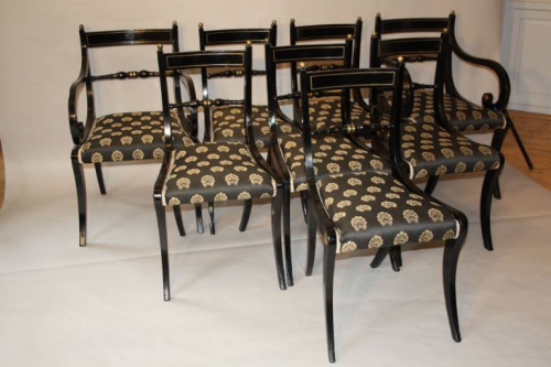 A set of eight brass and ebonised Regency dining chairs inc two carvers