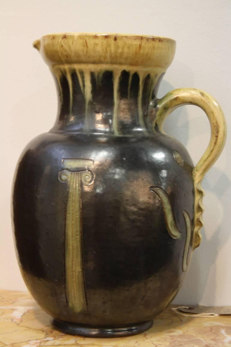 A large glazed ceramic jug
