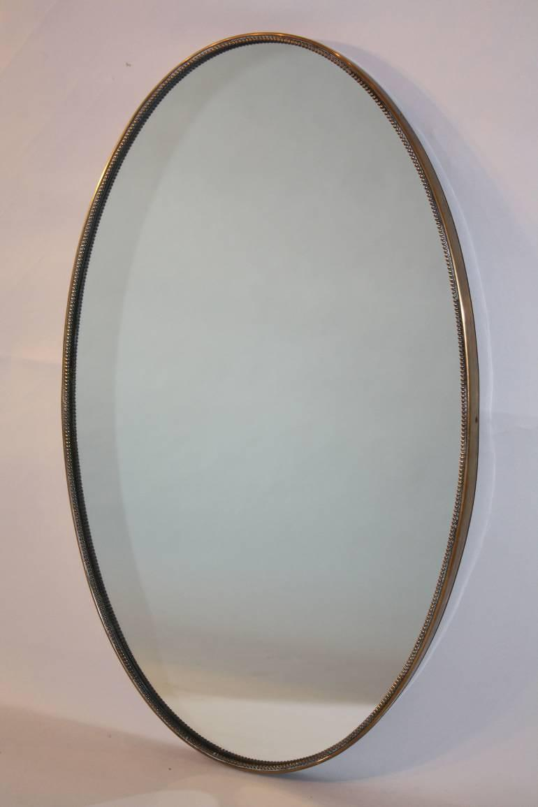 Italian brass and beaded oval mirror