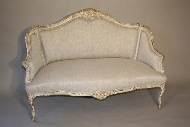 Carved wood French sofa
