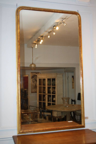 A large gilt gesso overmantle mirror