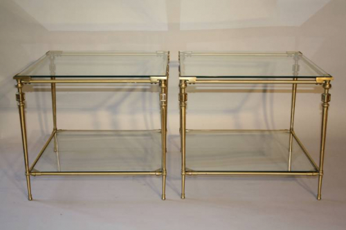 A pair of two tier brass side tables, French c1970
