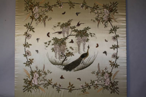 Hand embroidered Chinese textile of a peacock with butterflies, wisteria and roses. c1950