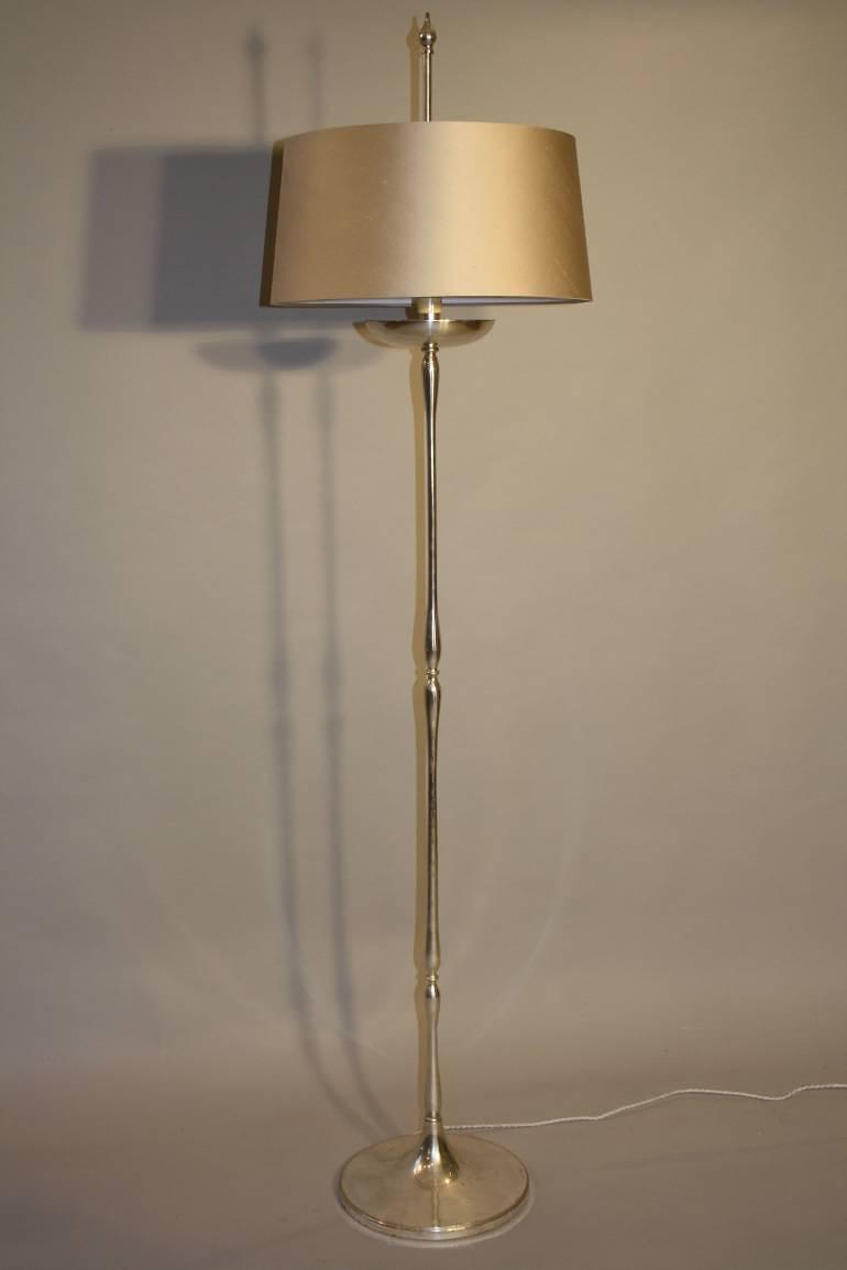 An elegant silver metal floor lamp, Spanish c1950
