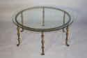 A Spanish gilt metal and glass circular coffee table. c1950 - picture 1