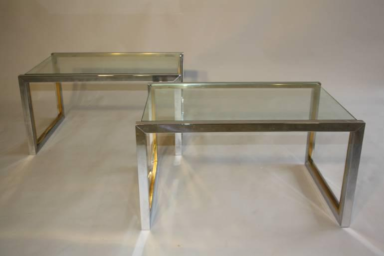 A pair of silver and gold metal and glass end/side tables, French c1970