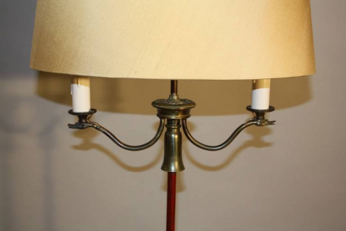 A red and gold metal, swan detail floor lamp, French c1950