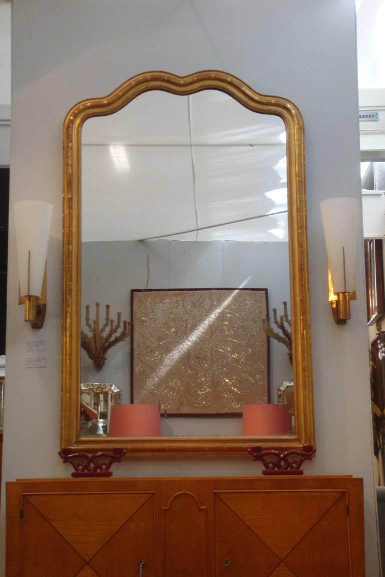 Large giltwood overmantle mirror with double serpentine top. Napoleon III, French c1850. Original mercury glass