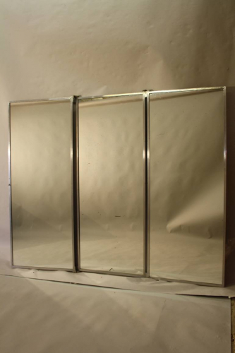 A silver aluminium triptych Brot style mirror. French c1950
