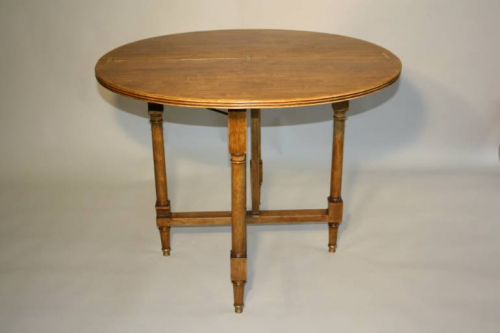 Circular folding four seat Walnut campaign table, French c1910