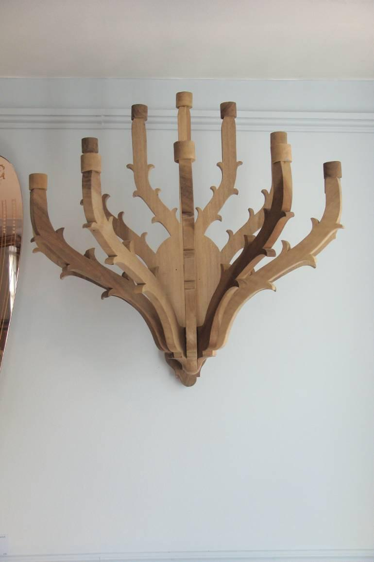 A pair of twelve branch carved walnut wall candelarbra