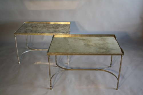 A pair of silver bout de canap