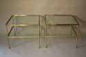 A pair of brass and glass two tier side tables - picture 1