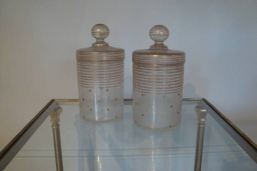 Pair of glass and painted gold lidded jars, c1930