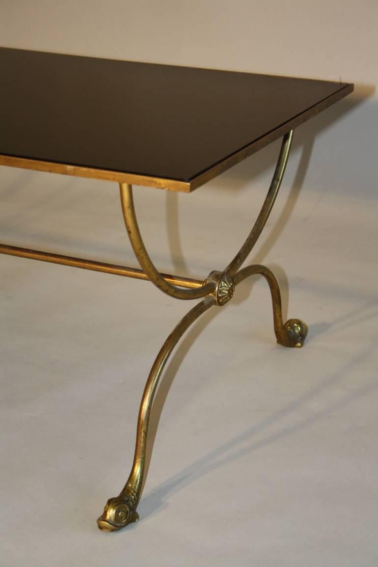 A black vitrolite glass and dolphin foot brass occasional table. French c1950